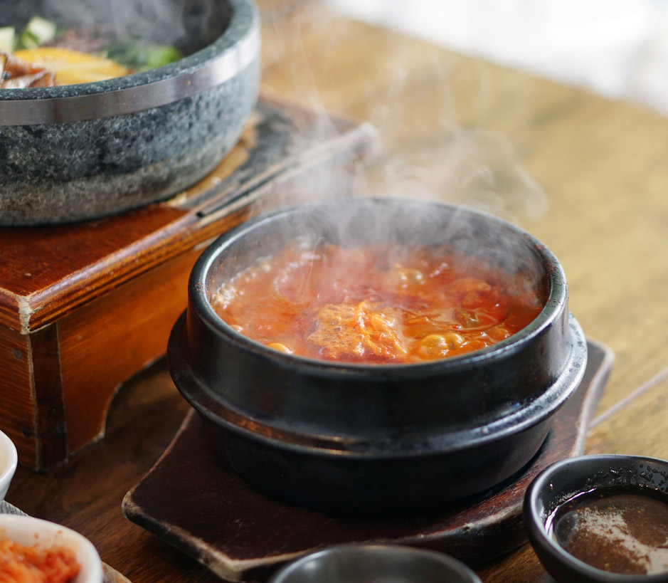 Kimchi Tofu Soup served in clay pot, One of the most-loved of all the stews in Korean cuisine, Most popular food in Korea.
